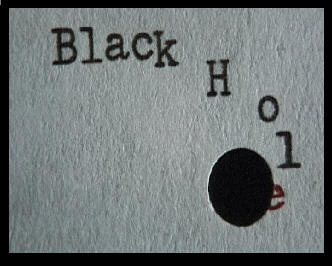 The typewritten words Black Hole dissapearing into a hole punched in the paper