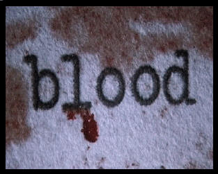 "The word ""Blood"" typed out on paper with blood oozing from the words."