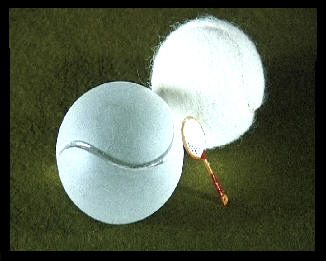 tennis ball with glass ball  too and two tiny tennis rackets