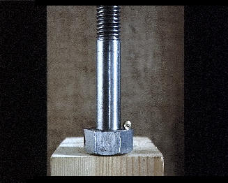 A big bolt and a small nut